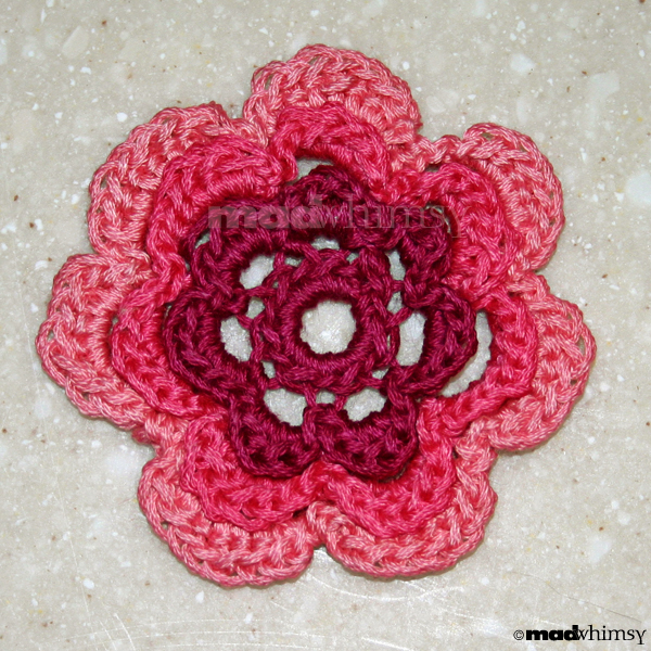 flower crocheted from 3 shades of embroidery floss